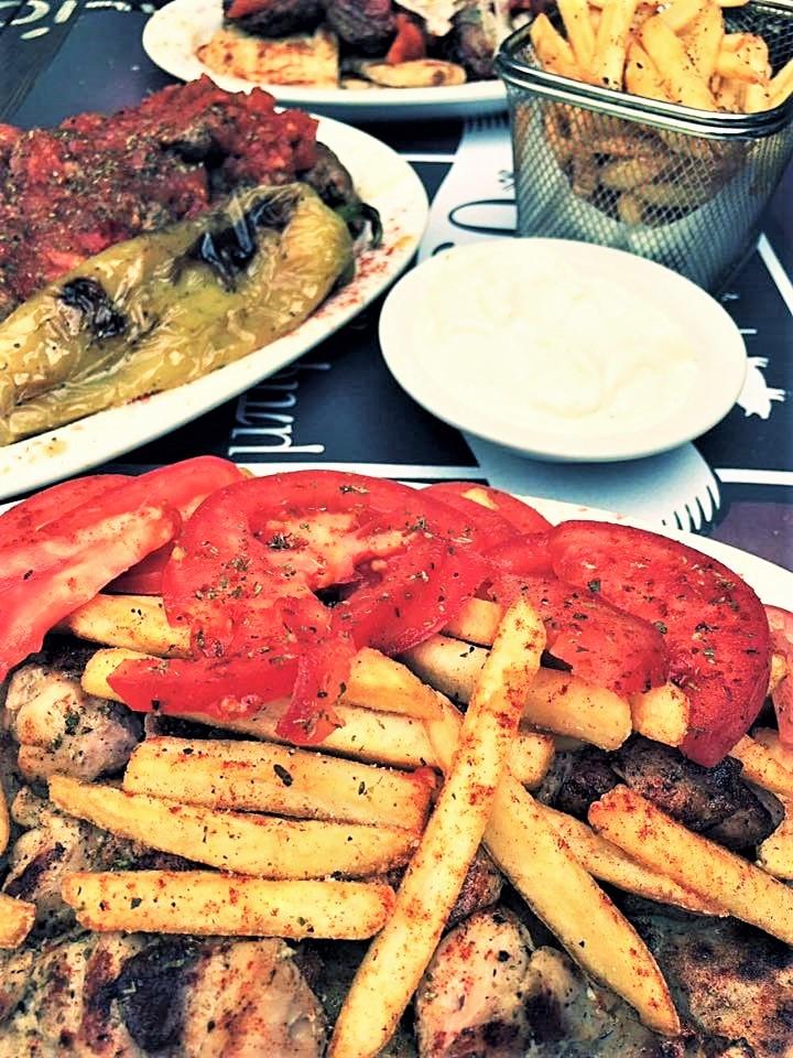 Greek souvlaki at  Mpiftekopoleio  in Kallithea, Athens. Source: Mpiftekopoleio