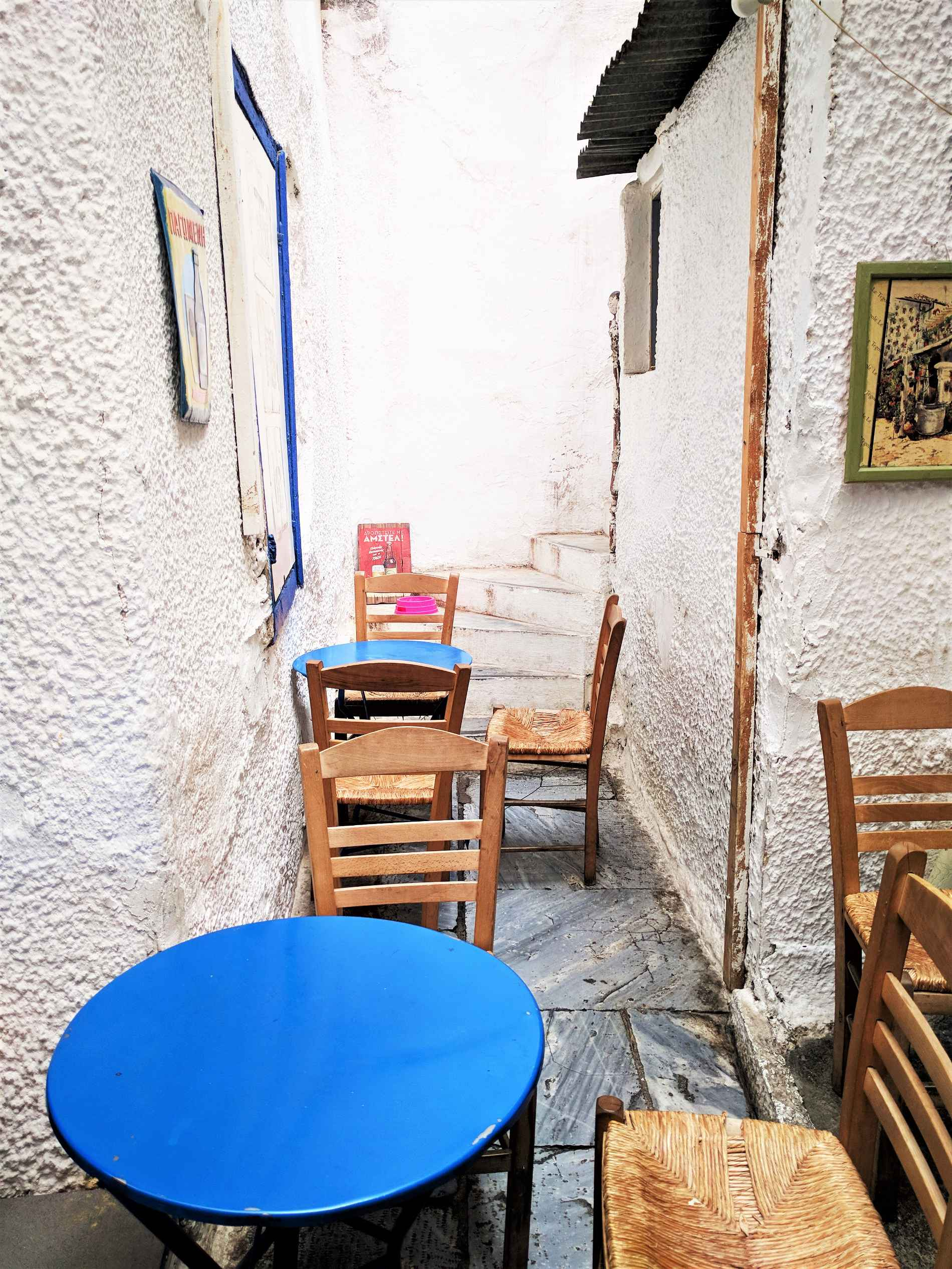 What could be more Greek than a blue and white yard in the center of Athens?  Avli  in Athens offers delicious and authentic Greek food. Source: Truevoyagers