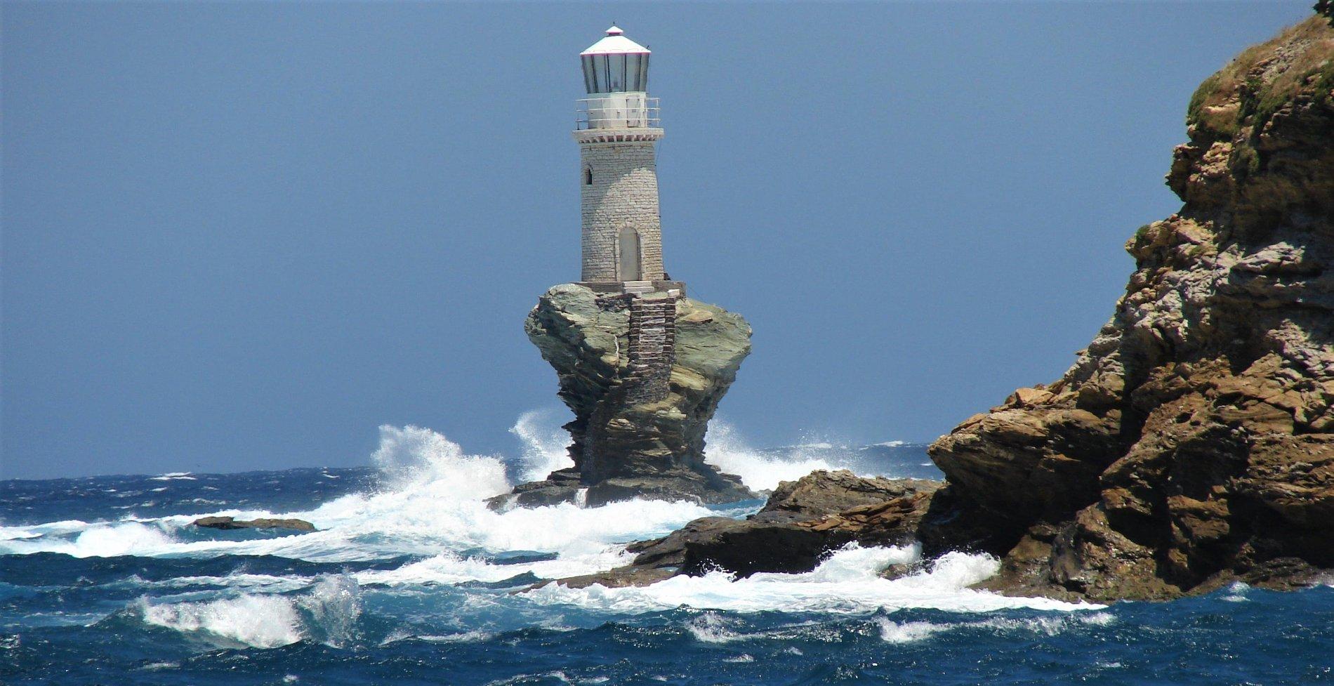 The impressive Tourlitis lighthouse of Andros island, Greece. Source: Alphacoders