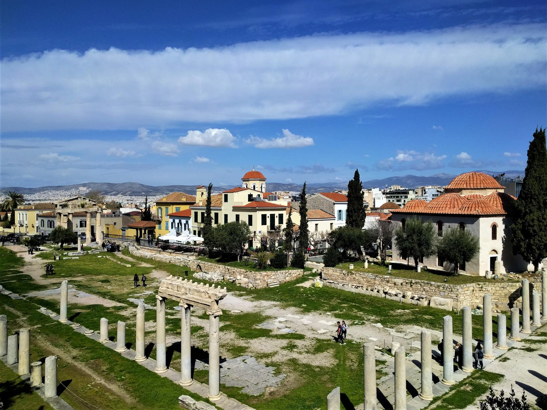 Plaka includes the majority of the must-see attractions in Athens, like the Roman Agora depicted here.
