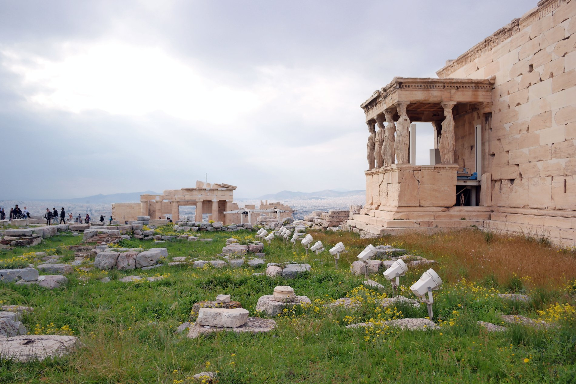 While at the Acropolis Hill, do not miss the Porch of the Caryatids in Erechtheion. Source: Truevoyagers