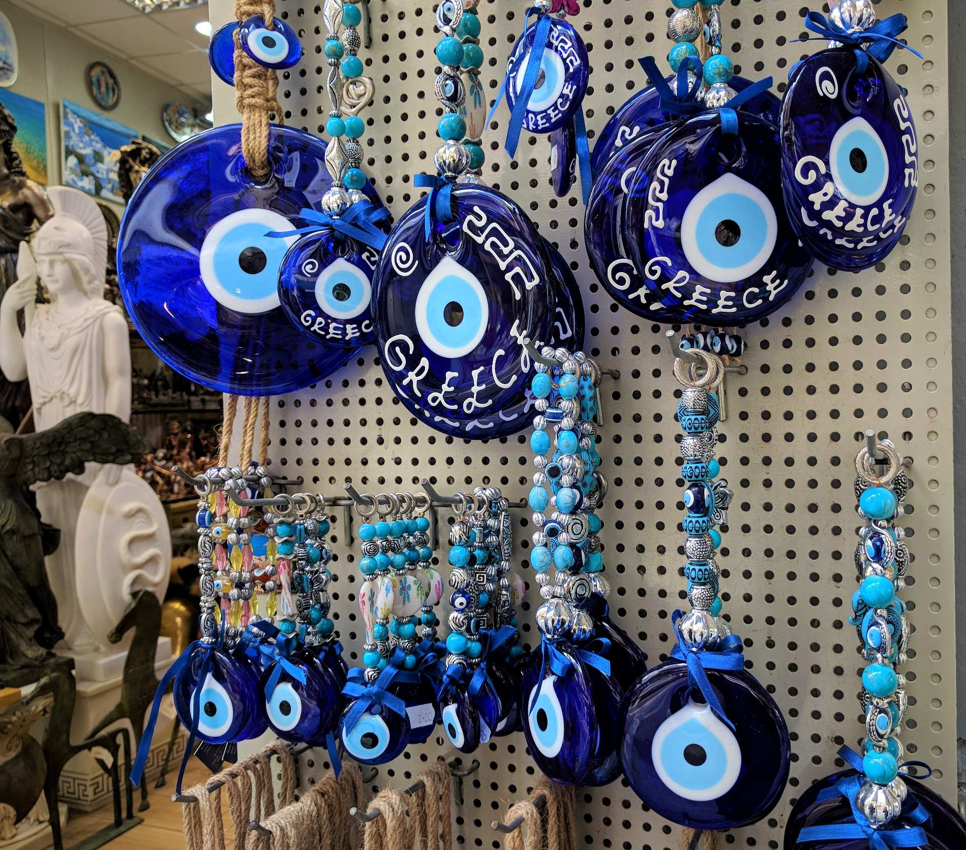"The peculiar blue talisman against evil eye that we call "" mati "" can be found everywhere in Monastiraki flea market. Source: Truevoyagers"