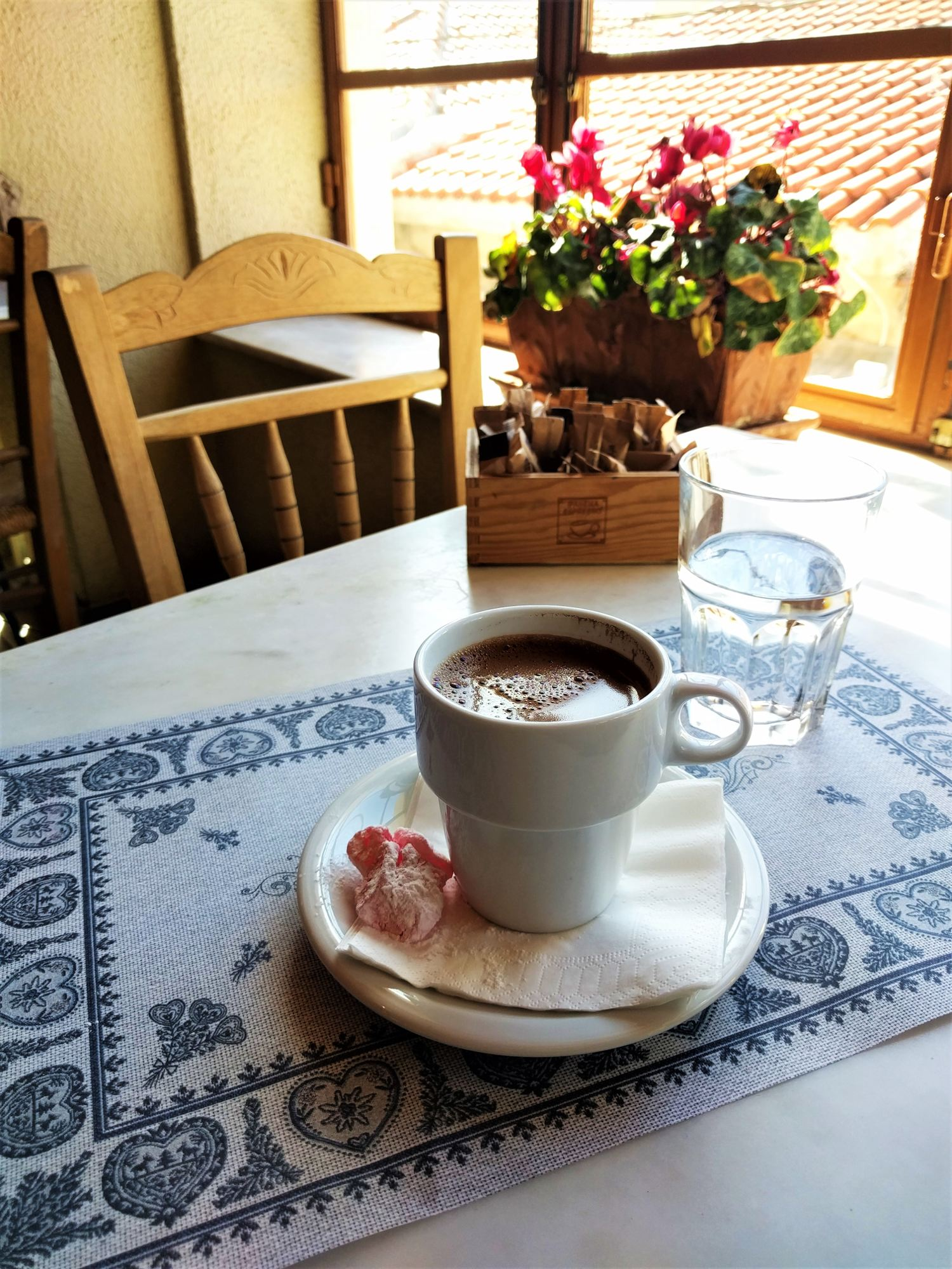 The traditional Greek coffee, served with cold water and a delicious  loukoumi . Source: Truevoyagers