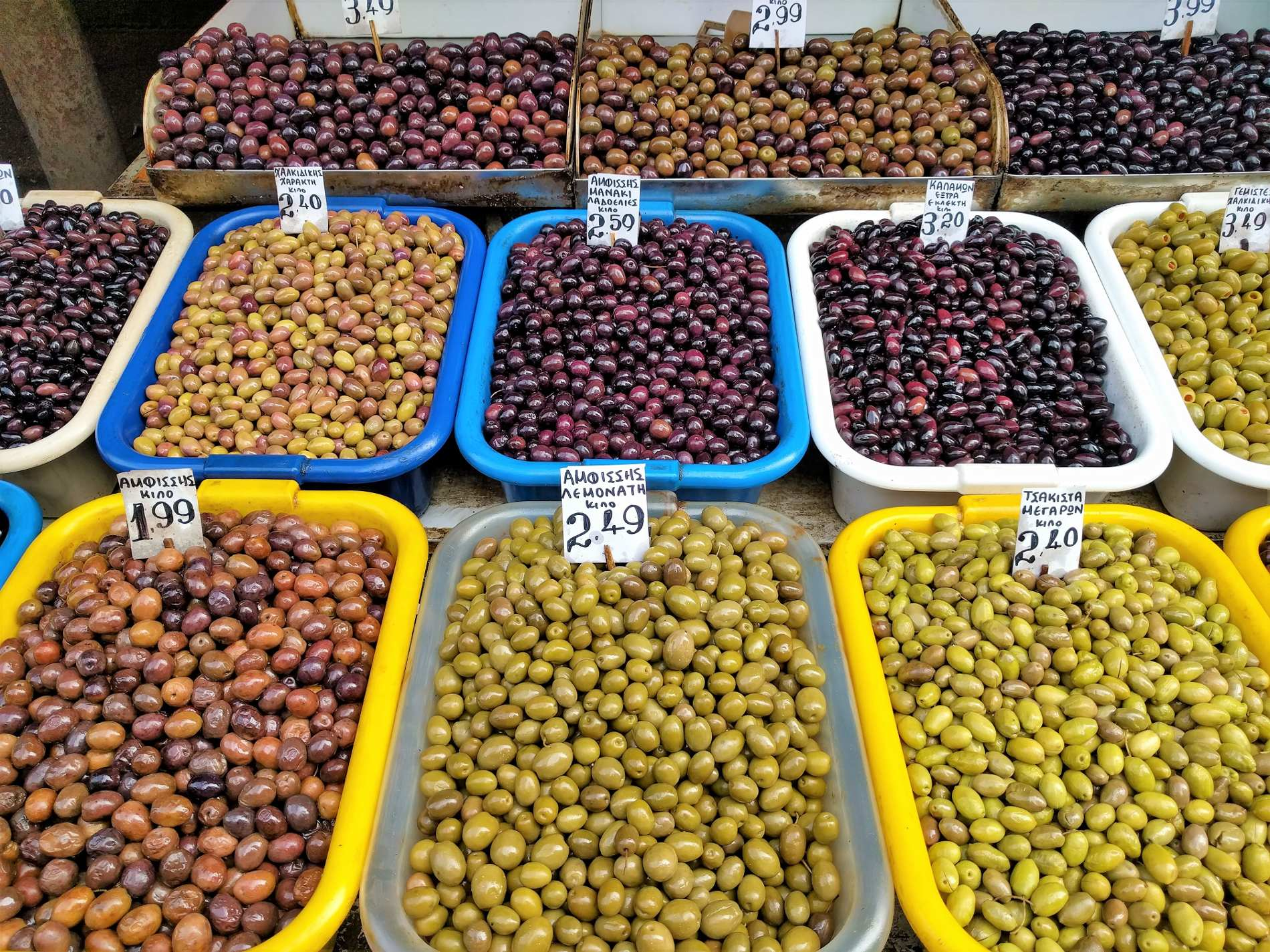 Try authentic Greek products while strolling around in one of the many open-air food markets in Greece.