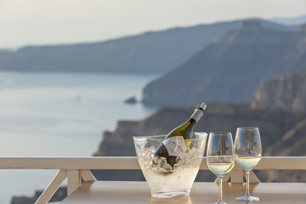 SantoWines  enjoyed with a magnificent Santorini view. Source: SantoWines