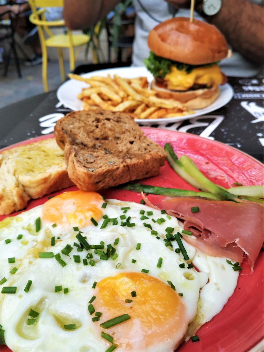 Sunny side up eggs with prosciutto at the  Underdog  in Thissio neighborhood of Athens.