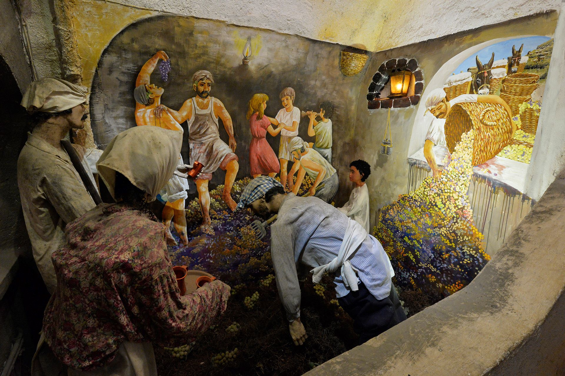 Stepping grapes inside the  Koutsoyannopoulos Winery  in Santorini. Source: Santorini Wine Museum