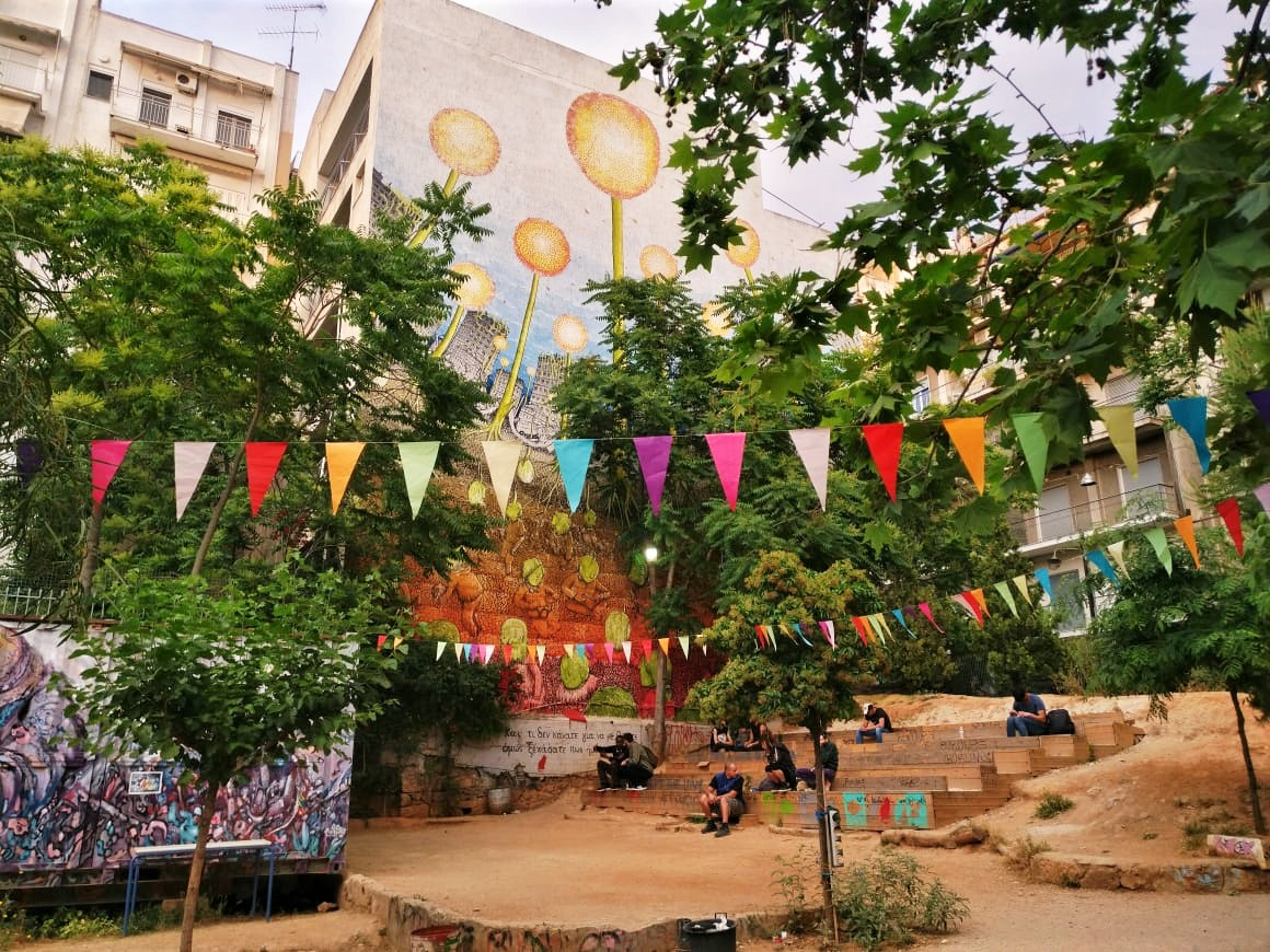 Watch the locals having a beer or a coffee, relaxing at their colorful park. Photo source: Truevoyagers