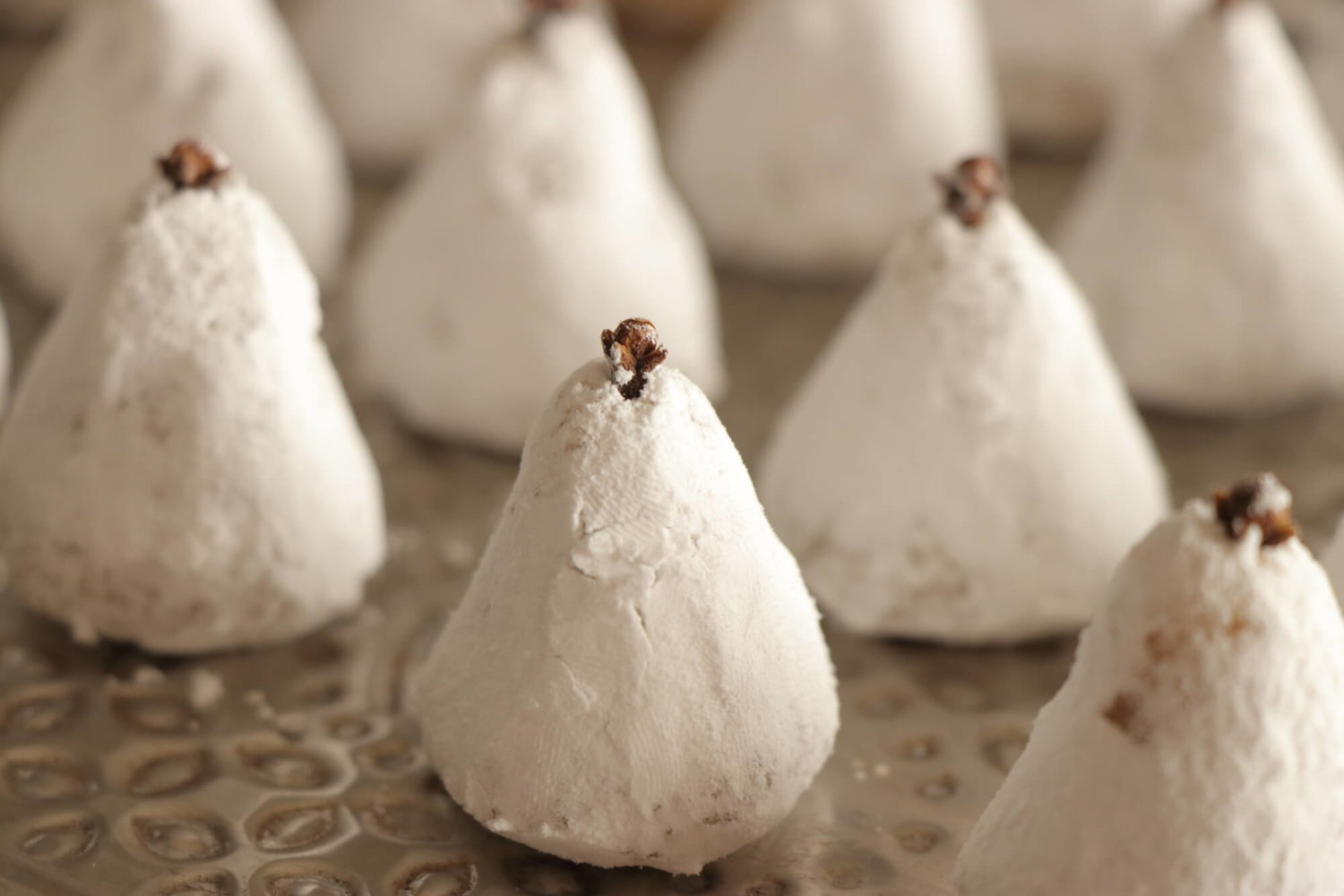 Amygdalota  come in a great variety, especially in the Greek islands. Here, pears covered in sugar and flavored with rose water are a delicacy usually offered in weddings in the island of Crete. Photo source: paxxi.gr