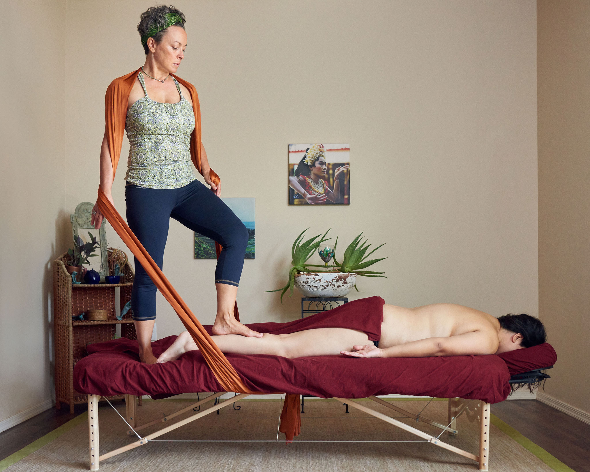 Maria Mitchell performing Sarga bodywork barefooted massage. (Click    Your Sole Journey    for more info).