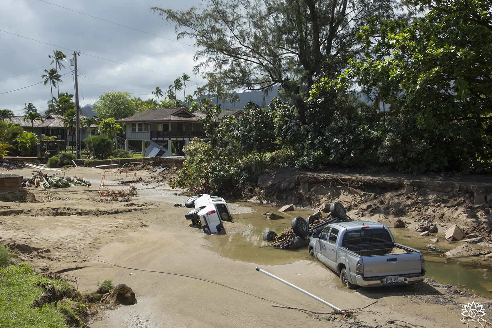 Hanalei on the island of Kauai after a flash flood took out roads and damaged cars and homes in 2018. - Photography by Paul Garrett