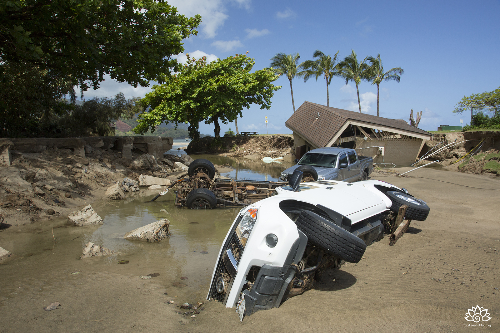 The communities beyond Hanalei were cut off by landslides that blocked the road and had to receive relief supplies by boat. - Photography by Paul Garrett
