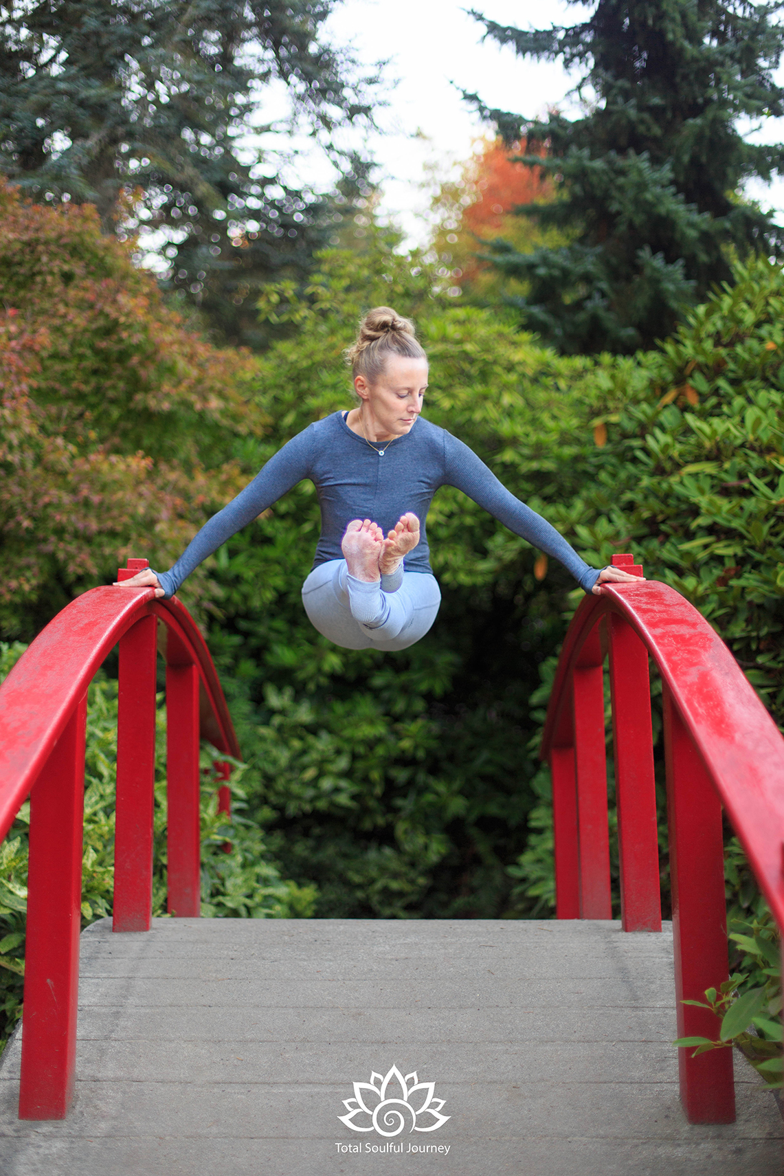 Robin Martin is driven by her passion for yoga and the pursuit of excellence. Many yoga poses require practice and determination to achieve. Photography by Paul Garrett
