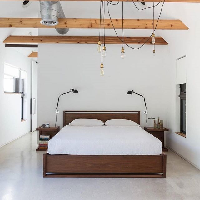 I love all things minimalism . #rePLANOLY @dwellmagazine . In Miami, a minimalist bungalow welcomes a sleek new addition. When a creative couple—a ceramic artist and a music aficionado— wanted extra space in their small two-bedroom home for their growing family and professional pursuits, they reached out to local firm @upstairs_studio_architecture to craft a solution. Not only did the team give the dated home a modern revamp, they also added an extension to fit a new master bedroom suite and study. To see the complete project, click the link in bio. - Photo by Claudia Uribe Touri @claudia_uribe_touri #minimalist #minimalistdesign #bedroom #exposedbeams #renovation #remodel #miami #florida #moderndesign #interiordesign #modernarchitecture