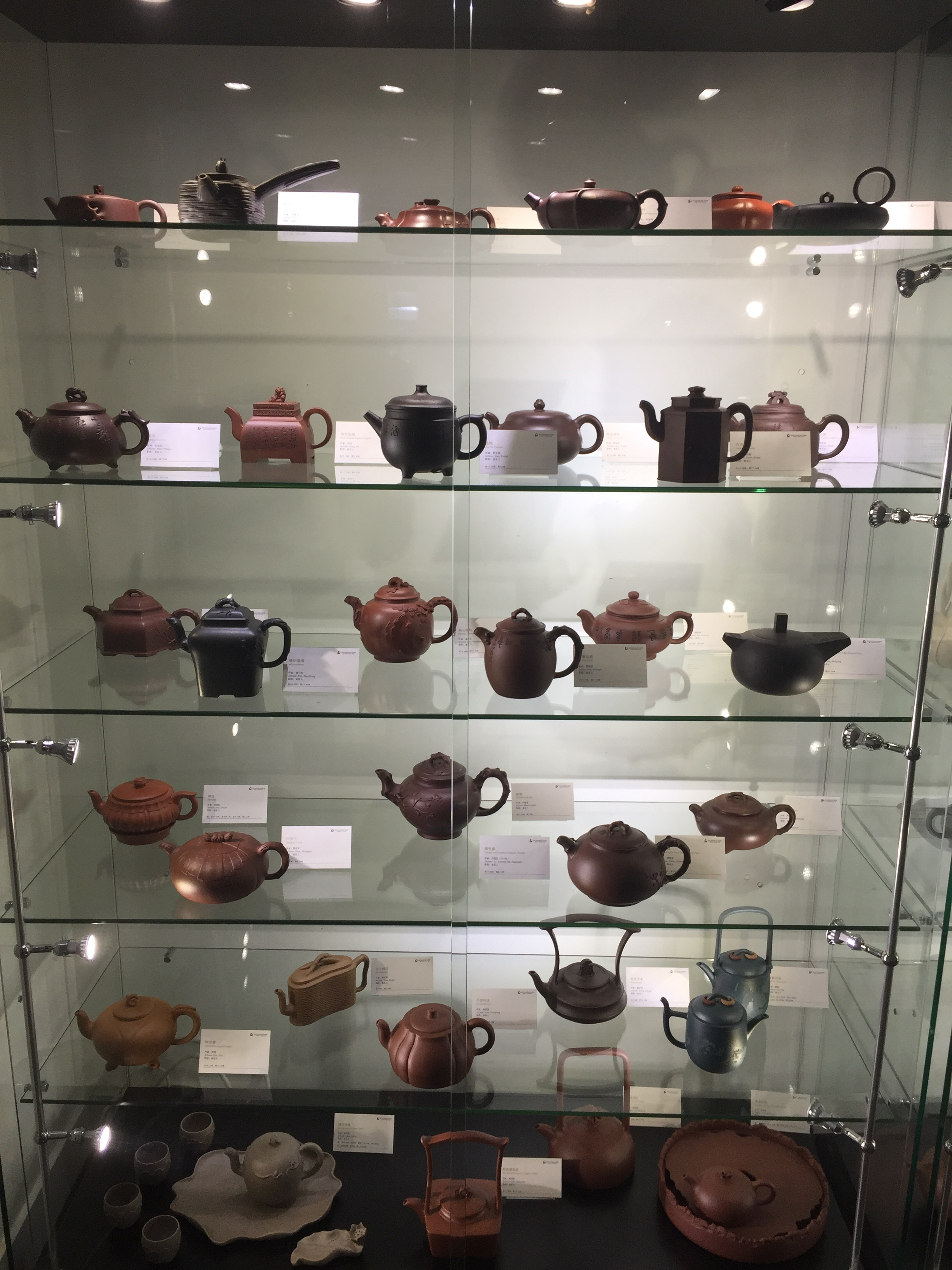 One of the many showcases containing yixing teapots.