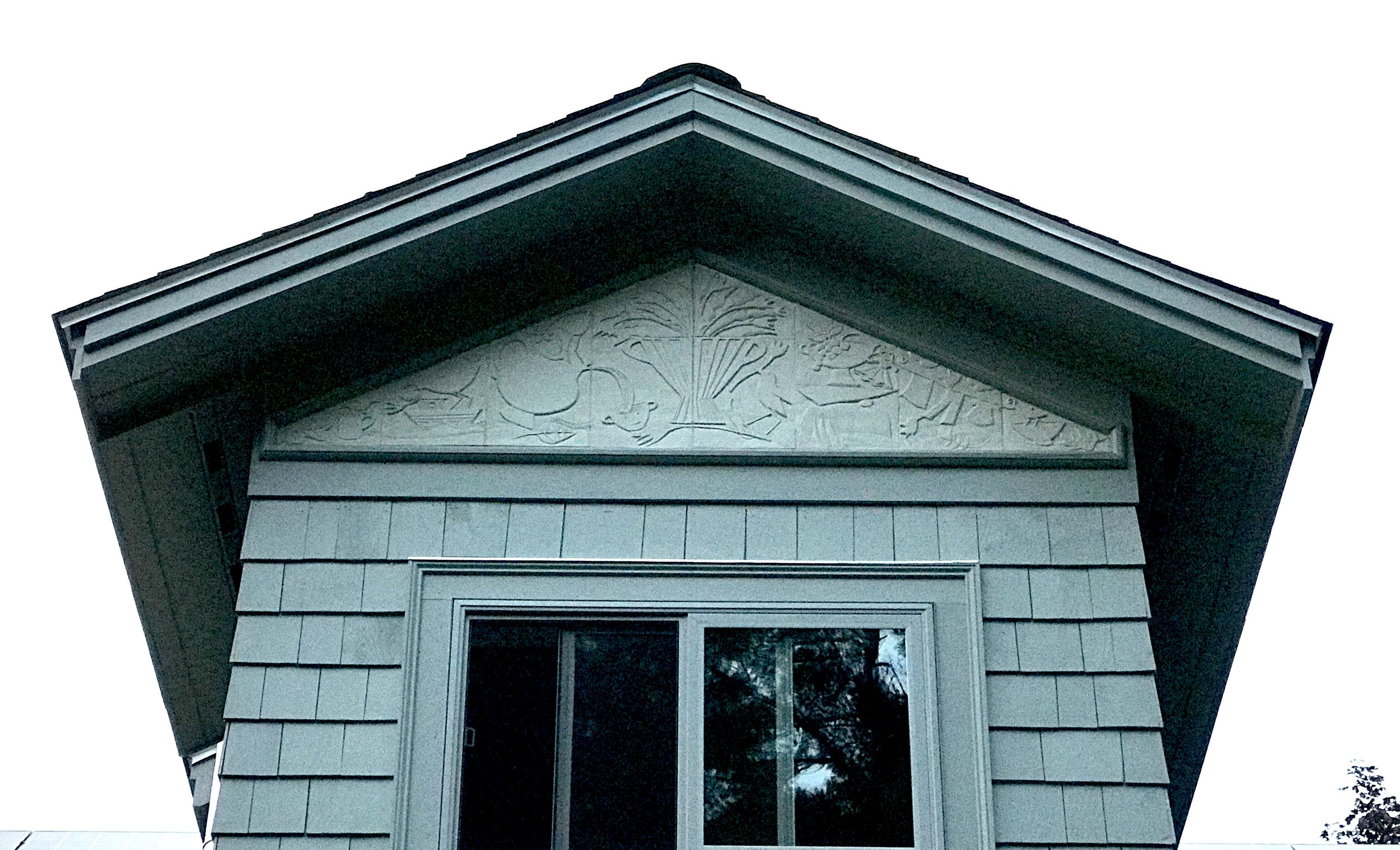 """This is an image of the finished ceramic pediment on our bathroom edition. The change from the last image posted here is the dramatic wooden framing.  It has been fun to live with this piece. It was a good experience for many reasons. This isn't the first time we made a piece that required a lot of attention to math and calculating shrinkage but it was very satisfying, when the piece was completed to know that it """"fit"""" the required size. We also hemmed and hawed about whether we should glaze the piece or not. One piece cannot do everything so we are both glad that we opted for """"subtle"""" rather than a dramatic color, surface or contrast of color. One thing that is worth thinking about is scale. While the images seem big up close, they are very small and detailed when seen from a distance. making greater allowances for the Size vs. Distance relationship may be considered differently the next time around.  The most """"telling"""" part of all of this will be Winter. We will watch the piece carefully to see how it weathers. We do live in New England. The generous overhang should alleviate almost any problem - it prevents any rain from coming in - but one can never tell."""