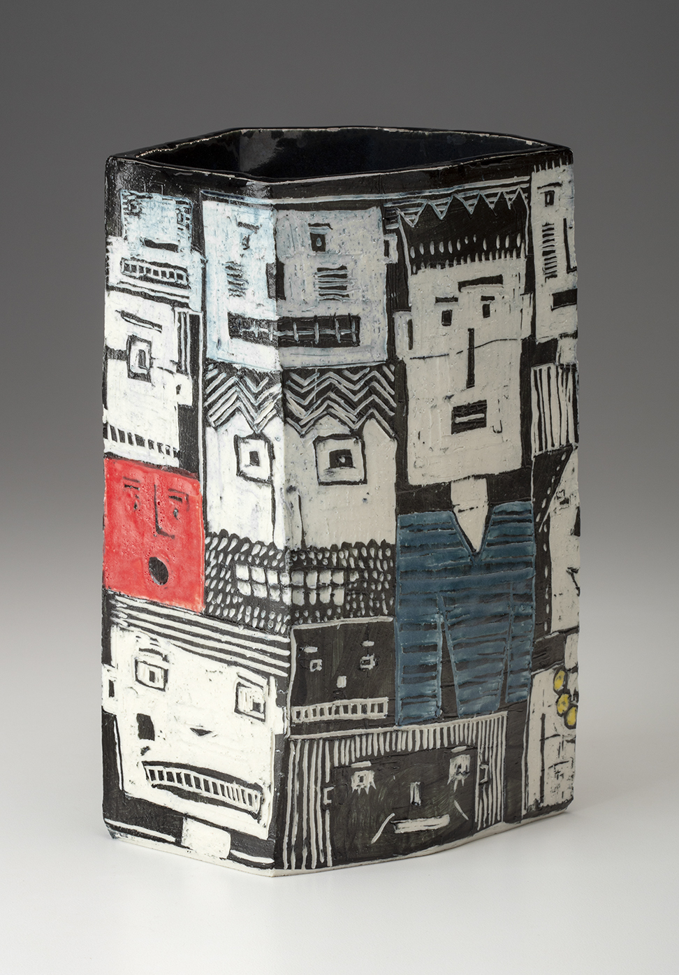 "This may be the second ""Blockheads"" vase. The changes that begin to happen are that the vases become more complicated in form and there continues to be experimentation regarding the best color to black and white ratio. The images are still very loose."