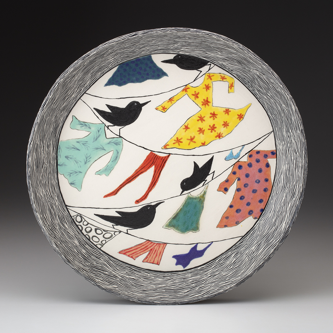 "Birds and Laundry plate, porcelain, sgraffito, glaze, 14.5"" x 1.5"""