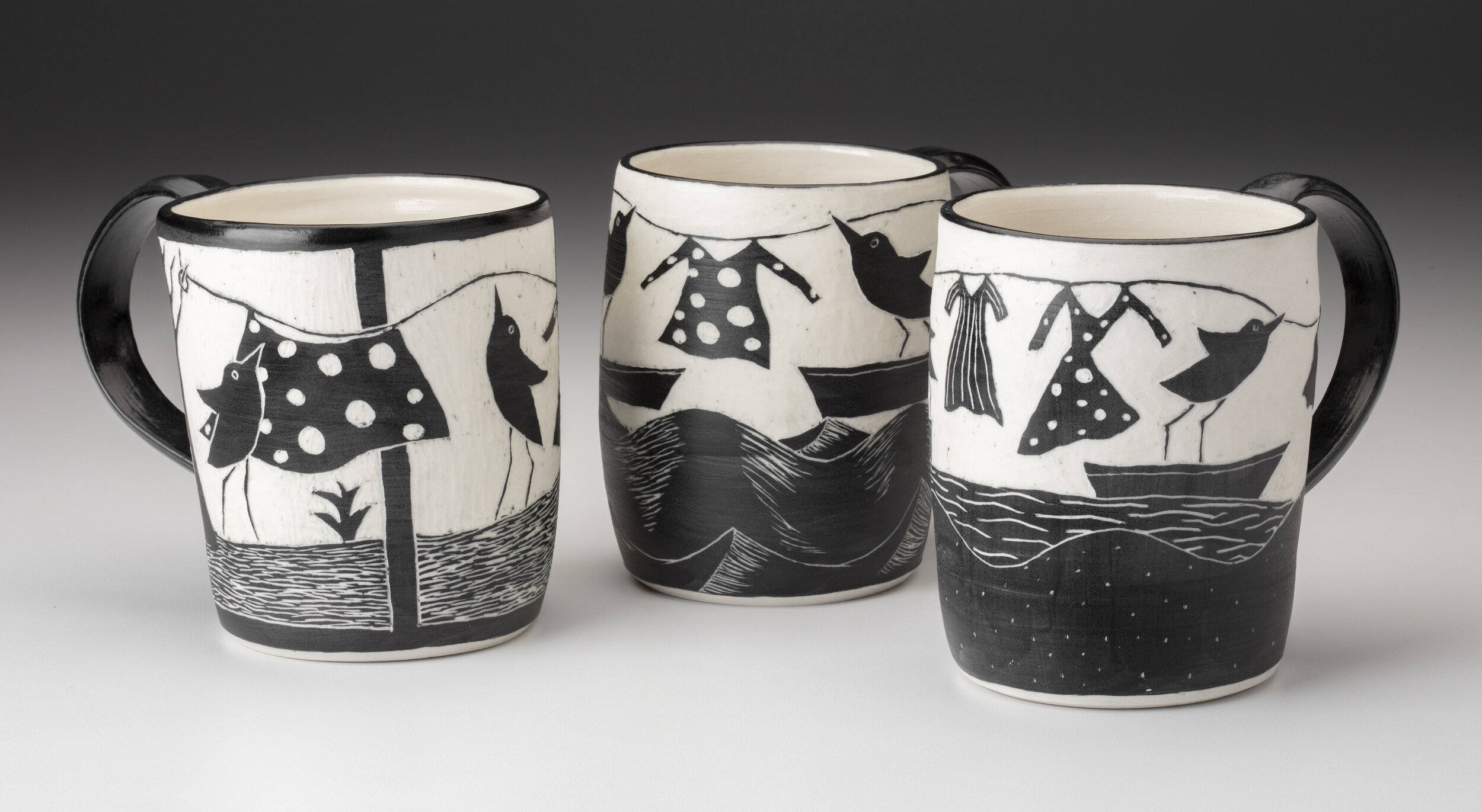 I am not certain of it was on purpose or not but it is interesting to see three totally different polka dotted objects on three different cups