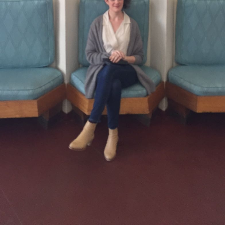 Sitting in the lobby of the Price Tower. Jesse Kamm Newton blouse, Madewell skinny jeans, Veronique Branquinho boots, J. Crew cardigan.