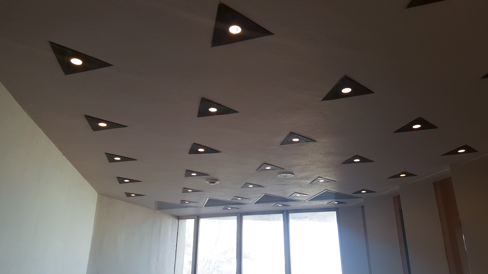 All the lights and air returns in the Price Tower were like these triangles!