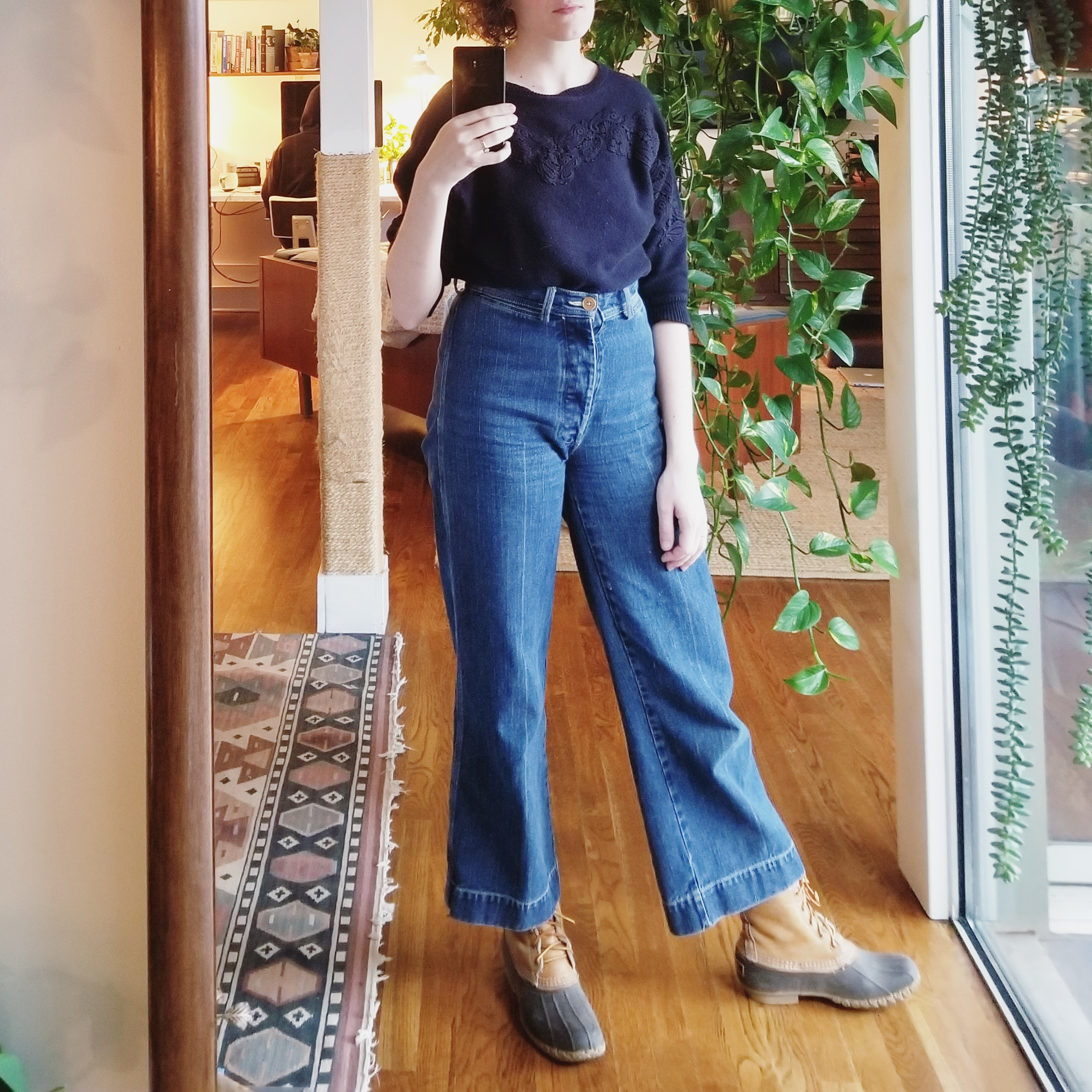Monday - January 8, 2018I love this silhouette — wide leg jeans with batwing sweater. This, consequently, is one of my two monochrome floral appliqué sweaters I've waxed on about. Atlanta schools are closed today because of the threat of snow! There was none.