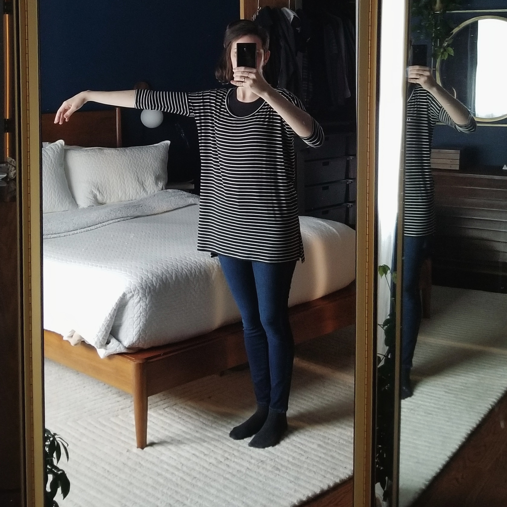 Tuesday - January 9, 2018I'm trying some outfit of the day shots in the bedroom! I love the light in here in the morningand the three-way mirror is ideal for full-length photos. My home design style is a little bit of a reflection of my personal style — somewhat neutral with statement pieces.