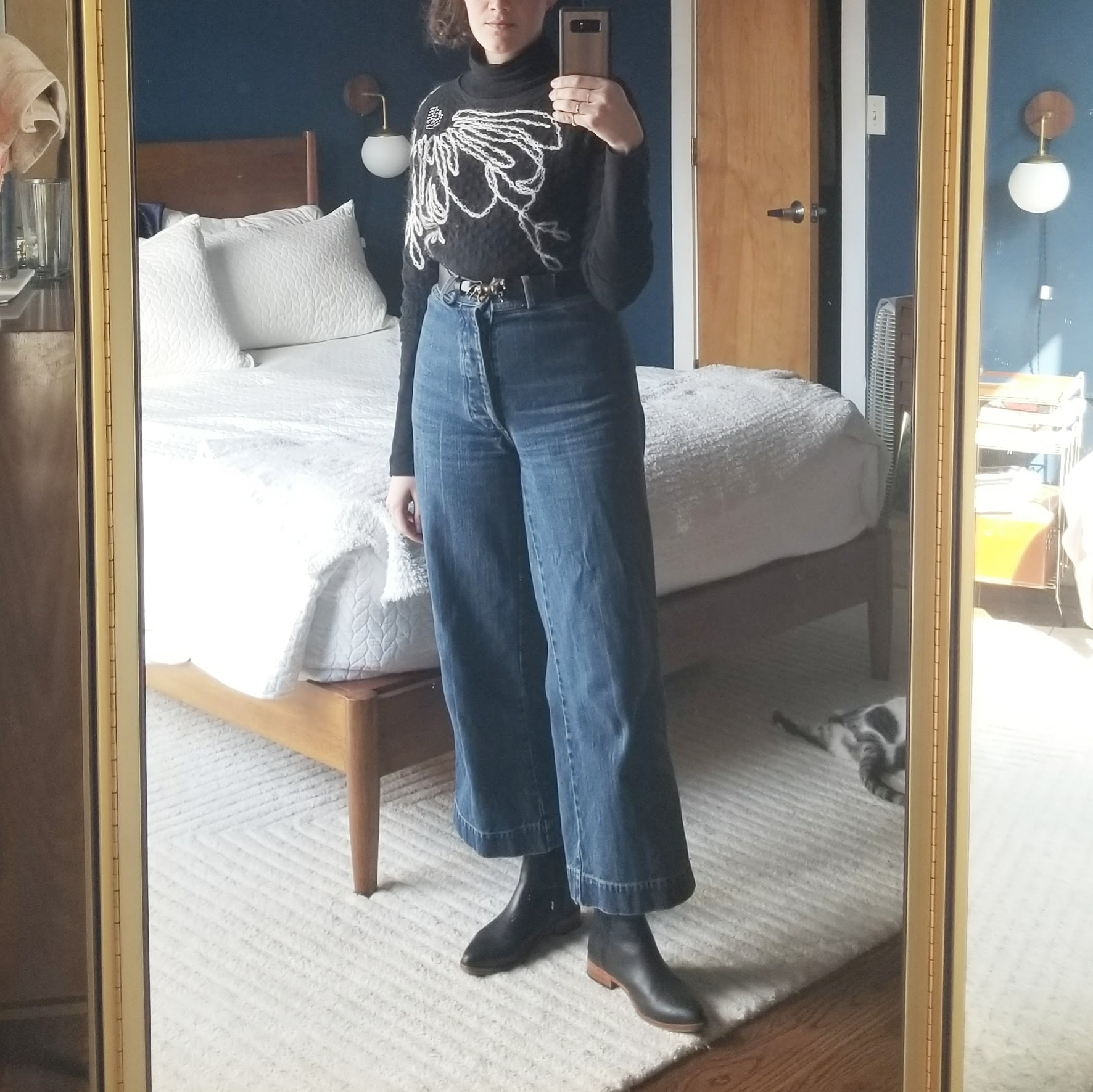 Thursday - March 8, 2018Caron Callahan jeans and a turtleneck/sweater combo. With the turtleneck and sweater both black, they blend together and make it look a little like one garment. The sweater is 3/4 sleeved which wasn't gonna cut it — so cold out this week!
