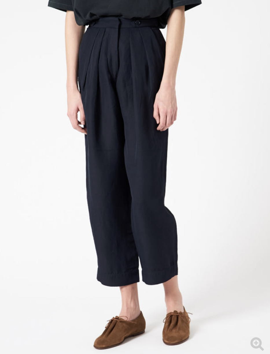 Studio Nicholson Bacci Pant - At $552 these are $$$. But so divine! Gorgeous pleating here. Pockets that follow the drape of the pleats. Leg width stays out of culotte territory.Studio Nicholson is a brand I don't know much about, but I know these check a lot of my style boxes. They look so comfortable too! Would absolutely wear these.