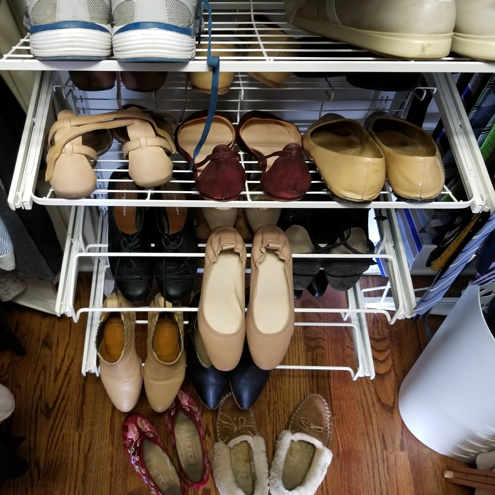 27 pairs of shoes. - That's my count. Is that a lot? It's hard to tell.
