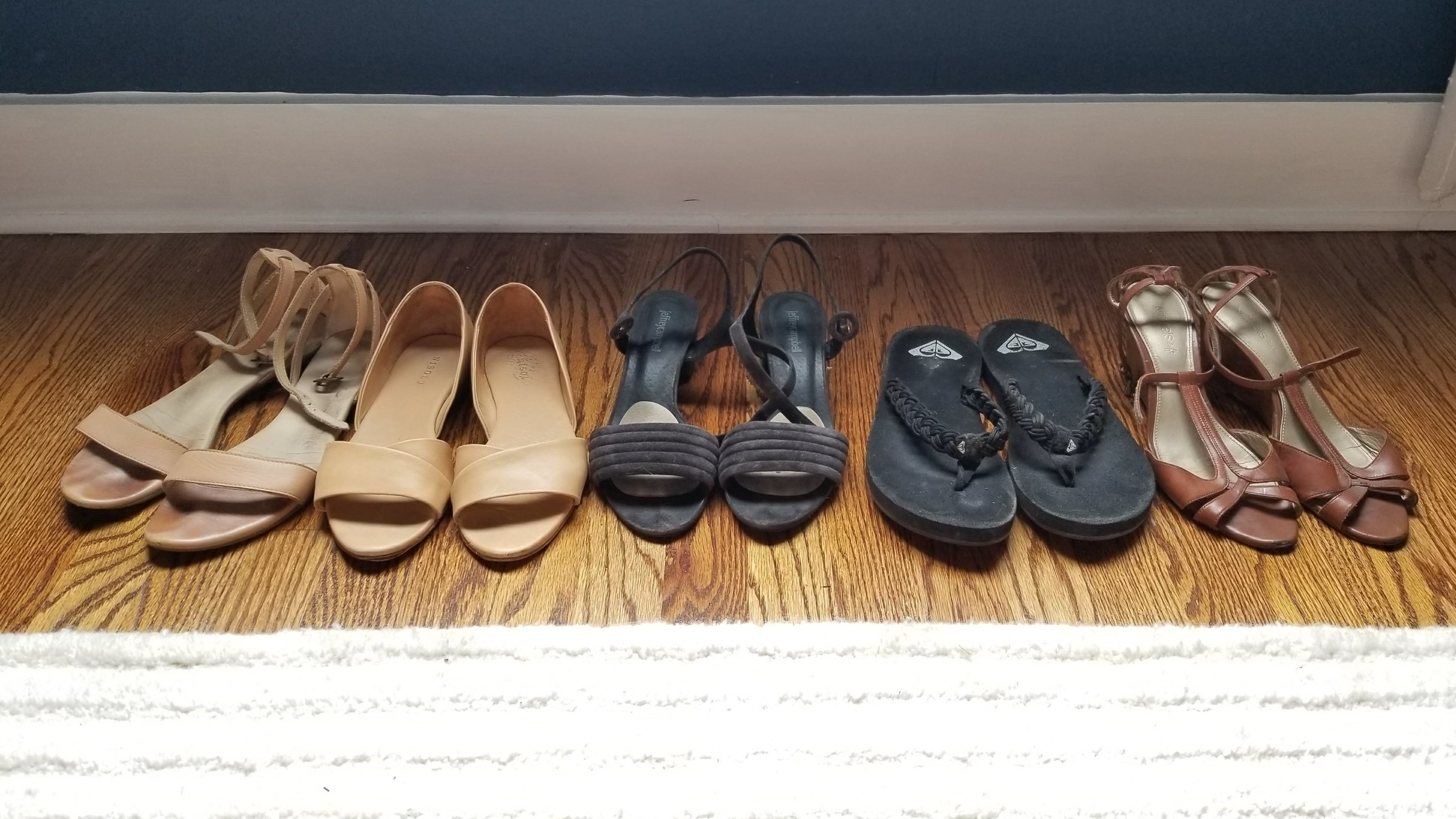 L to R: Nisolo 2-piece ankle straps, Nisolo 2-piece that gives me blisters, suede block heels, flip flops, wedges. Not pictured: wedding shoes (see below).