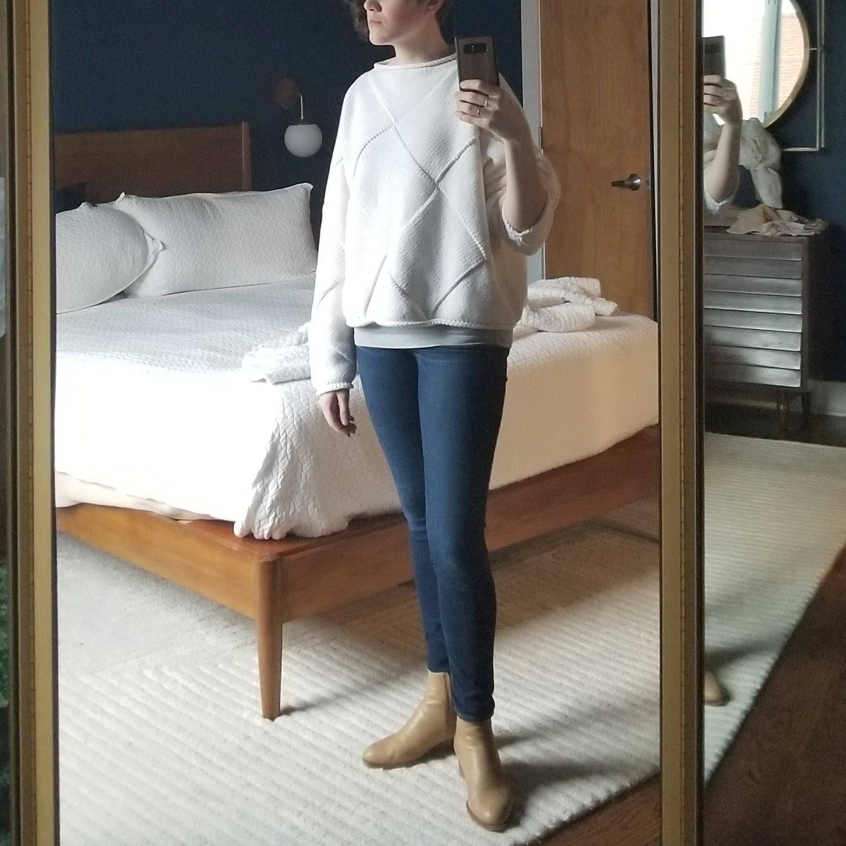 Monday - March 26, 2018Here it is, the Lauren Manoogian sweater. I'm wearing a fitted top underneath that I've allowed to peek out, which adds a little dimension and foundation to the sweater. The sleeves on the sweater are very roomy but taper to just the right width to allow me to push them up to my elbow for things like hand-washing without fear of soiling the sleeve. With this being white, I will need to take extra care not to rub the sleeves on random surfaces. It's that kind of soiling more than blatant stains that make white look dingier than it should. This might be the last time I get to wear this sweater til the fall but that's OK! I'm so happy with it. It's like wearing a blanket, both in weight and warmth. Just what I needed all winter, haha.