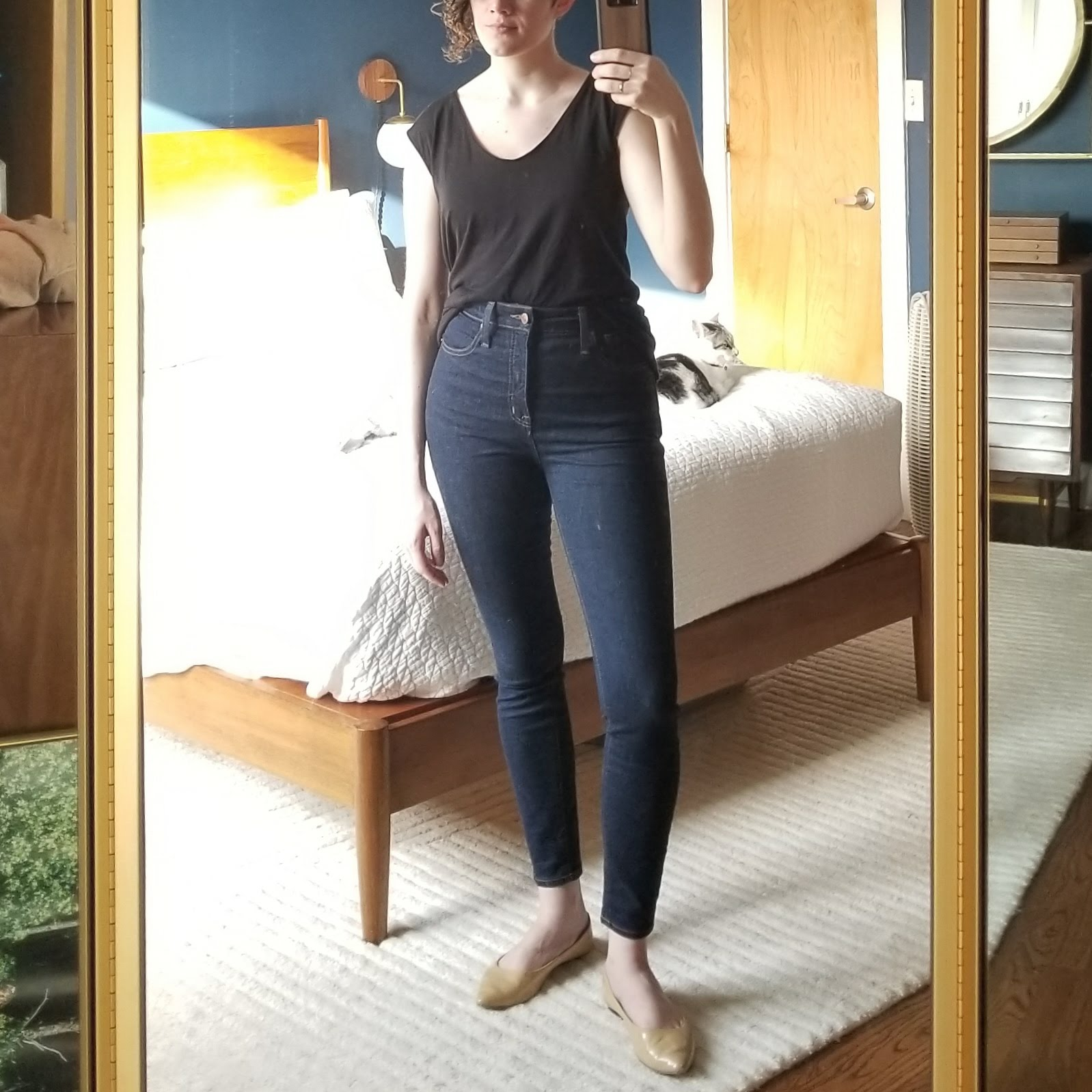 Thursday - March 29, 2018Work from home day! Super basic look. I didn't even wear these shoes because I wasn't leaving the house, I just put them on for the outfit of the day picture, haha. These jeans are a new acquisition from Poshmark — they're the Madewell curvy fit high rise skinny jeans. I'm planning on selling my current pair of regular fit skinny jeans so it's an even swap. After both my sisters raved about the curvy fit, I tracked down a pair secondhand and am really happy with them. You probably wouldn't look at me and say