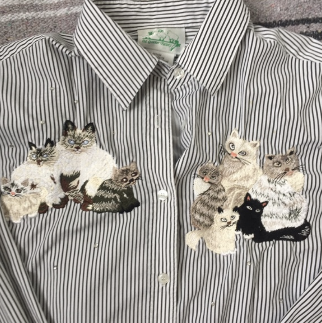 Embroidered house cat button-down - Let's just get this one out of the way because it is TOO silly. I don't understand the world of embroidered button-downs, but it is vast and vibrant. Who ever used to wear this? Who BOUGHT this? It even has rhinestones! It seems like a product of the style of embroidery, but the cats all have really funny faces, kind of cross-eyed. I appreciate the hell out of this shirt but WOULD NOT WEAR.