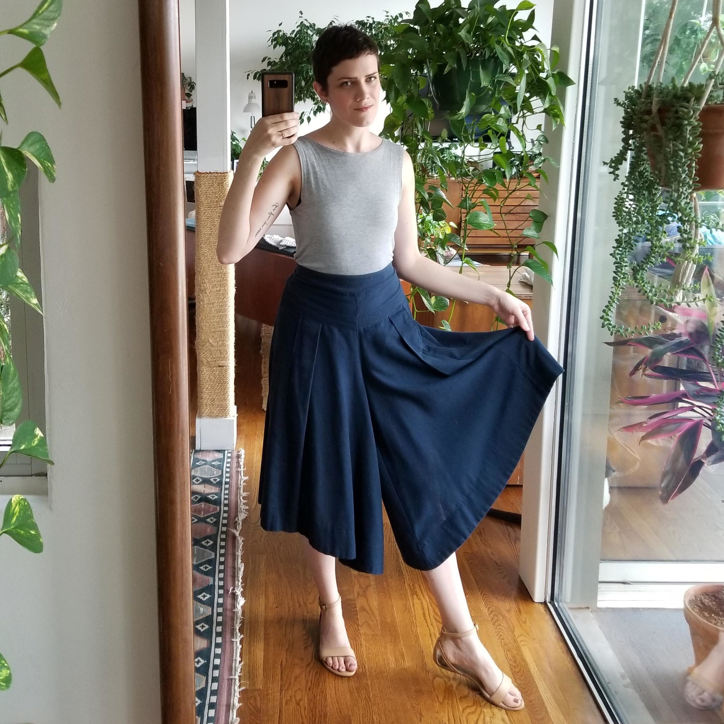 Saturday - June 23, 2018Haircut pup! First day with a new 'do. I picked up these navy blue pleated culottes when I visited my aunt in Vancouver almost five years ago now. They still feel so current in my wardrobe! I have to do a major shimmy to get them over my bubble butt because they are flat front/elastic back, but once on they fit great. I've thought about adding a zip fly to them or something because I always hate to shimmy, but I worry I'd ruin them somehow in the process.