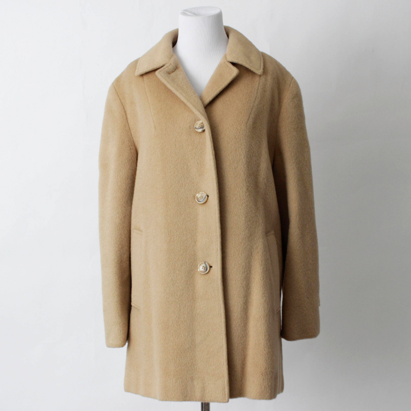 Camel coat - $69 / 100% wool / Ships from USAClassic style, even more classic color. You can't beat the price either for 100% wool. At first it appears to have the same three-button styling just like Everlane, but when you look closely you'll see a fourth button at the collar they threw in for free! No more chilly necks.