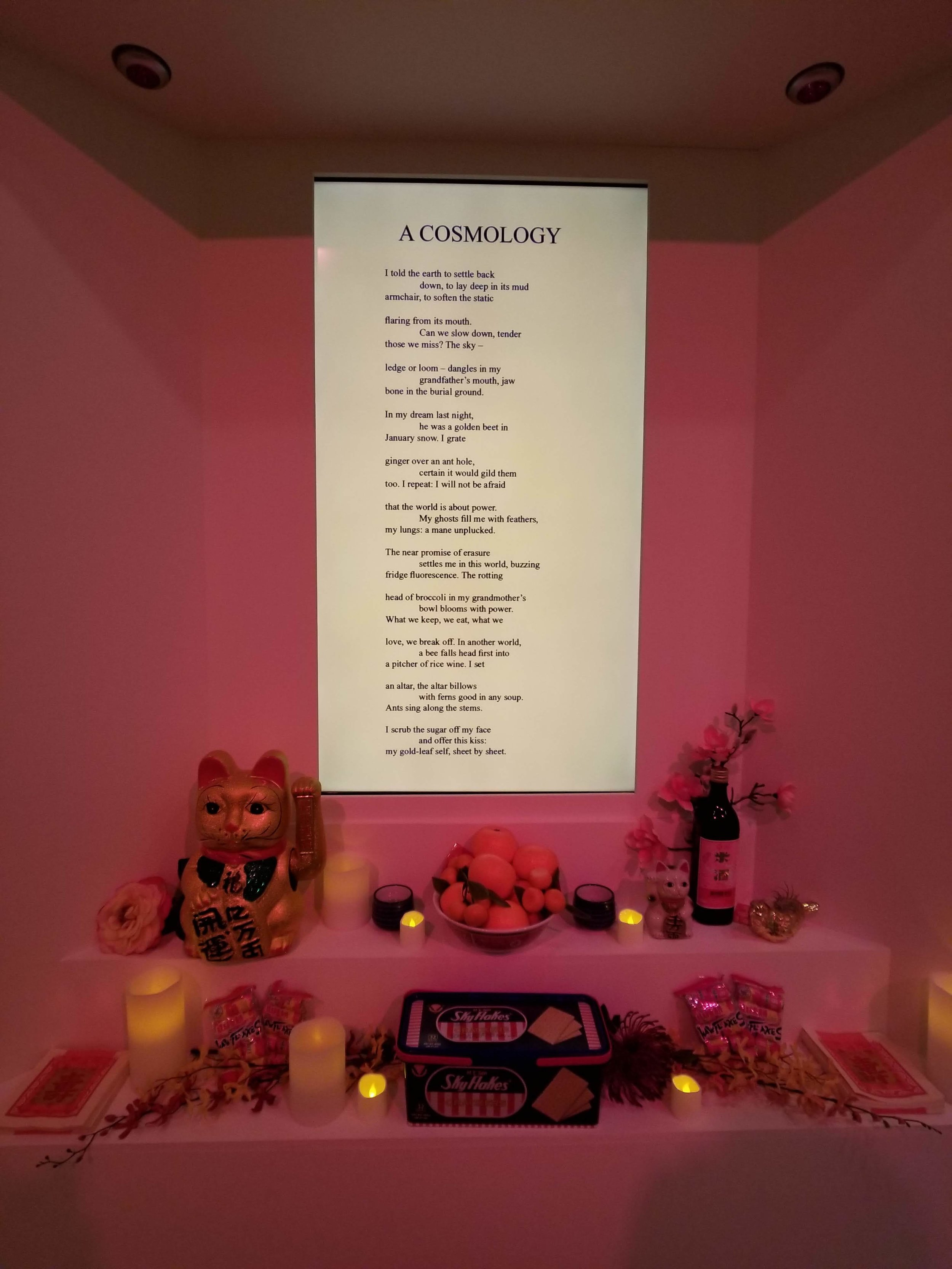 """""""In my dream last night, he was a golden beet in January snow."""" My favorite line from the poem """"A Cosmology"""" by Jane Wong. An altar frames the screen on which different poems would rotate."""