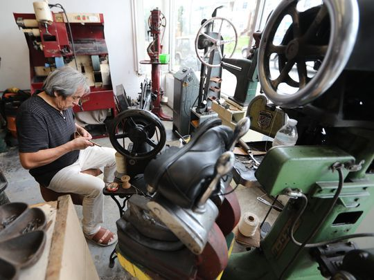 Acuna's menagerie of old machines includes a foot-pedaled Singer sewing machine and a hand-spun machine that threads leather. (Photo: Kevin R. Wexler/NorthJersey.com)