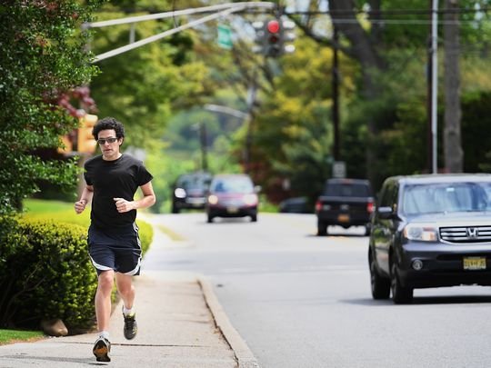 For his first cross-country run, Slava Koza embarked from Dillon Beach, Calif., north of San Francisco, in April 2012 and ran 3,055 miles to Lincoln Center in New York City, arriving 118 days later.  Photo: Michael Karas/Northjersey.com