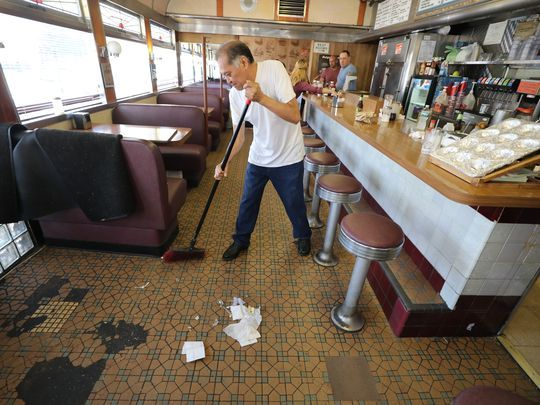 Salvador Suarez cleans up after the final lunchtime at the Egg Platter Diner in Paterson.  Photo: Chris Pedota/NorthJersey.com