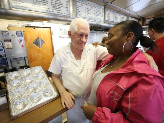 The Egg Platter's co-owner, Tom Philis, 73, says goodbye to a longtime customer, Elizabeth Mathis-Smith of Clifton, who has been coming to the diner for over 30 years. Photo: Chris Pedota/NorthJersey.com