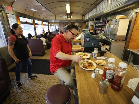 """Bob Ogorzaly, who grew up in Paterson, returned to the Egg Platter from his home in Charlottesville, Va., for one last breakfast: two eggs, home fries, Taylor ham, French toast, white toast and coffee. He planned to return later in the day for a couple of Taylor-ham-and-egg sandwiches — """"for the road,"""" he said. Photo: Chris Pedota/NorthJersey.com"""