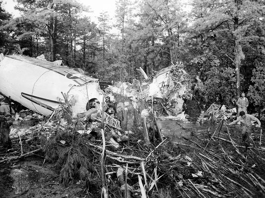 The almost intact main cabin, left, and the completely crushed nose section, center right, of a Douglas Liftmaster transport plane lie in the woods at McGuire Air Force Base, near Fort Dix, after the plane crashed shortly after takeoff on July 13, 1956. Of the 66 people onboard, 45 were killed and 21 injured. The plane was bound for England.  Photo: Bill Ingraham/AP