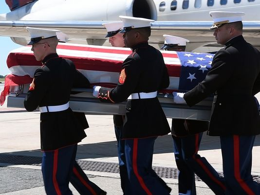 The casket holding the remains of Marine 1st Lt. William C. Ryan Jr. of Bogota is carried into the hearse that will take it to Arlington National Cemetery for burial. Photo: Danielle Parhizkaran/Northjersey