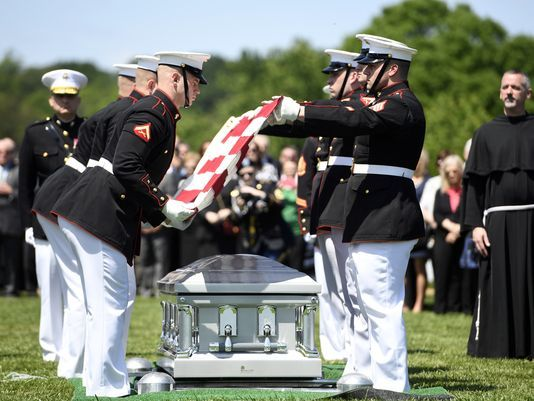 U.S. Marines fold the American flag draped over the casket bearing the remains of Marine 1st Lt. William Ryan during his military funeral service at Arlington National Cemetery on Wednesday.  Photo: Danielle Parhizkaran/Northjersey.com
