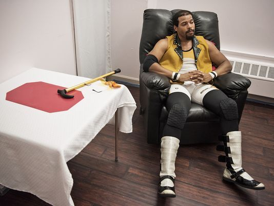 "Nick Shinholster, who wrestles as ""Soul Train Nick Shin,"" rests after a match at the Independent Wrestling Federation school in Nutley.  Photo: Michael Karas/Northjersey.com"