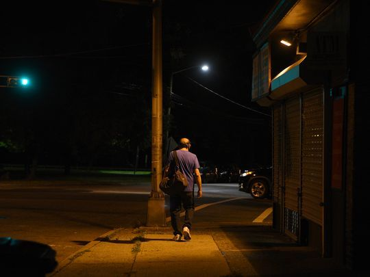 Leaving home at 4 a.m., Edgar Acosta walks up Clifton Avenue to catch the first of two jitney buses that take him to the Deerbrook Fabrics factory in Guttenberg. He arrives at the factory by 6 a.m. to start the looms. Photo: Amy Newman/NorthJersey.com