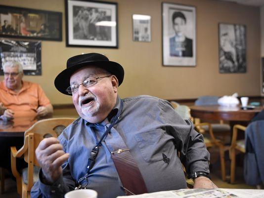 Don Kommit in a favorite haunt, drinking espresso and reading the funnies.  Photo: Danielle Parhizkaran/Northjersey.com