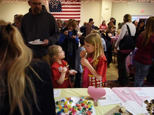 Soph Kayen, 6 (center), and Lovina Crouthamel, 8, sample some baked goods.  Photo: Michael Karas/Northjersey.com