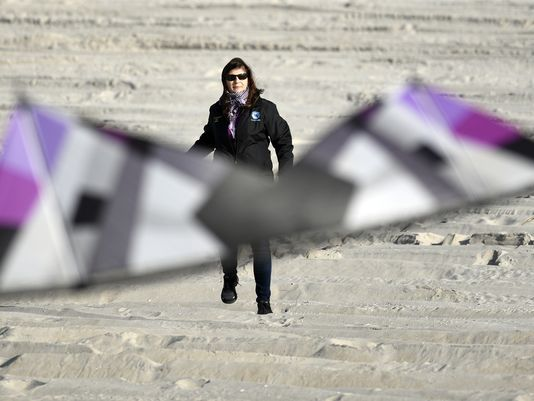 Lisa Willoughby flies a kite near her home in Surf City, New Jersey.  Photo: Danielle Parhizkaran/Northjersey.com